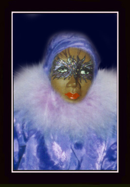 Click here to view closeup of the African American Doll, Naomi, A Mardi Gras Masquerade Doll